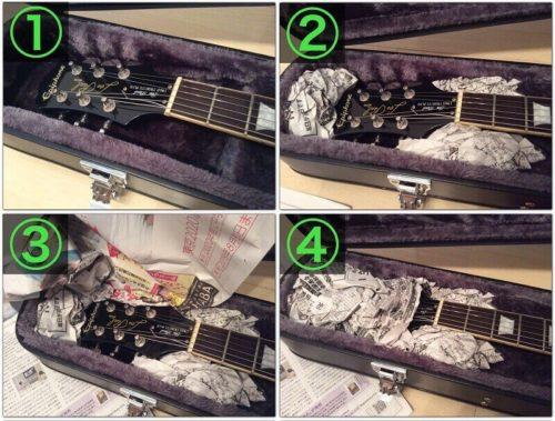 新聞紙でギターを固定する様子