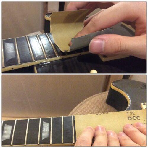 紙やすりを使ってフレットの錆を落とす様子