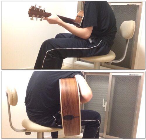 猫背で座ってギターを持つイメージ